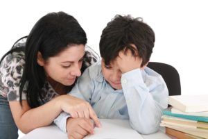 10945290 - mother helping with homework to her son indoor